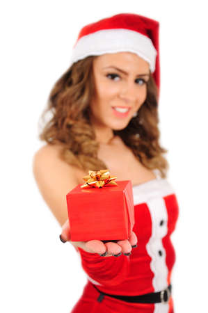 Isolated young christmas woman showing gift photo
