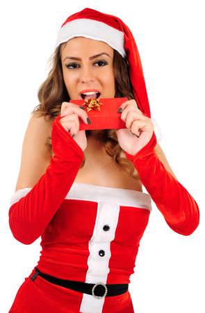 Isolated young christmas woman bite gift photo