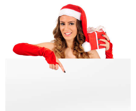 Isolated young christmas woman presenting Stock Photo - 16641192