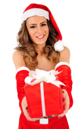 Isolated young christmas woman giving gift photo