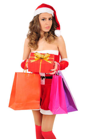Isolated young christmas woman with shopping bag photo