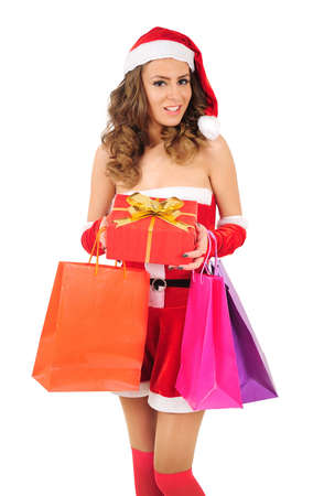 Isolated young christmas woman with shopping bag Stock Photo - 16641189