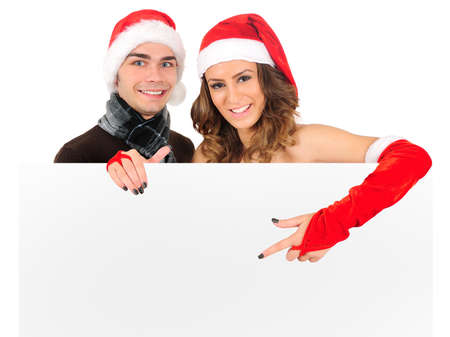 Isolated young christmas couple presenting photo