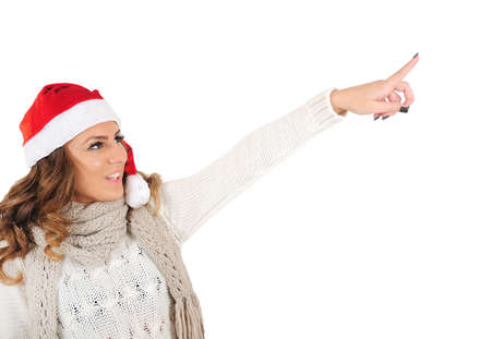 Isolated young christmas girl pointing photo
