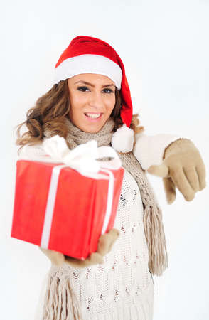 Young girl in christmas suit with gift photo