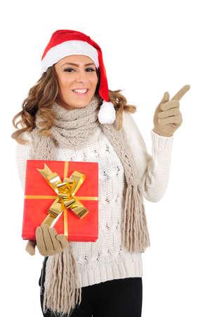 Isolated young christmas girl holding gift Stock Photo - 16641063