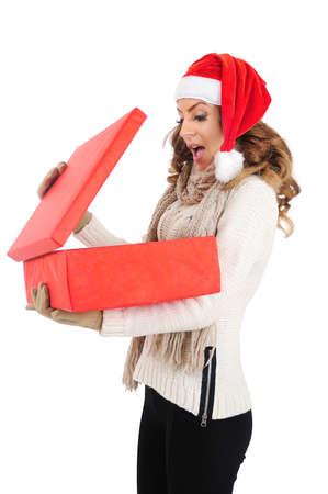 Isolated young christmas girl holding gift photo