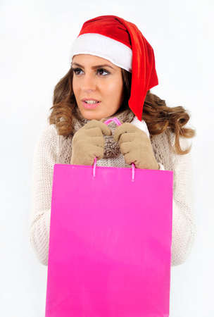 Young girl in christmas suit with shopping bag photo