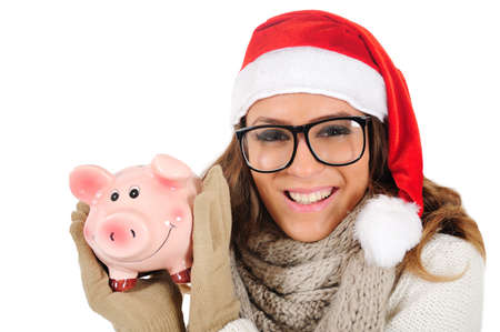 Isolated young christmas girl with piggy Standard-Bild