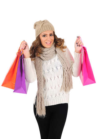 Isolated young casual woman with shopping bag photo