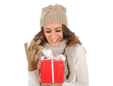 Isolated young casual woman opening box photo