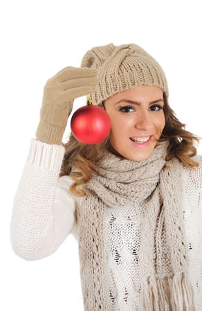 Isolated young casual woman showing christmas ball photo
