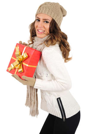 Isolated young casual woman holding gift photo