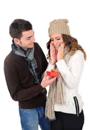 Isolated young christmas couple with gift photo
