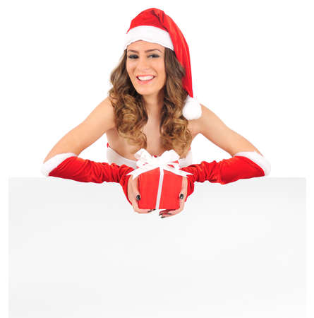 Isolated young christmas woman presenting photo