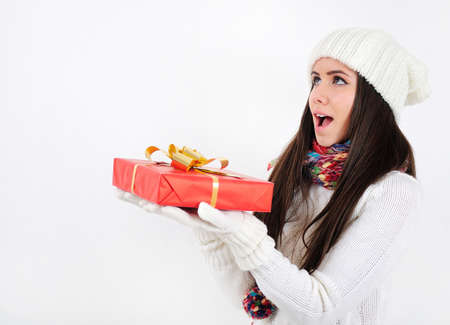 Young casual girl with gift photo