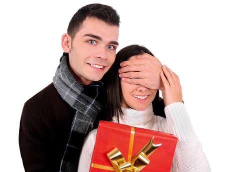 Isolated young casual couple with gift photo