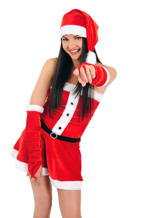 Isolated young brunette christmas girl pointing photo