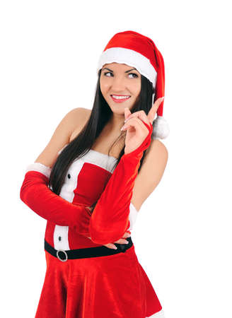 Isolated young brunette christmas girl pointing Stock Photo - 16764056