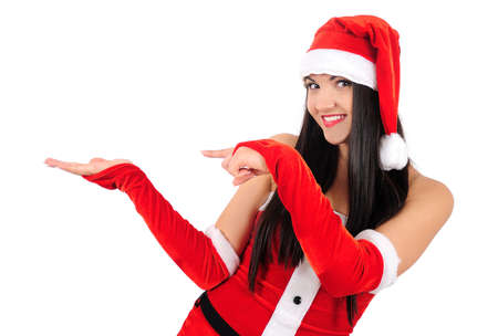 Isolated young brunette christmas girl pointing something Stock Photo - 16764035