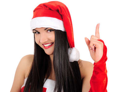 Isolated young brunette christmas girl pointing Stock Photo - 16764119