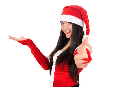 Isolated young brunette christmas girl showing ok photo