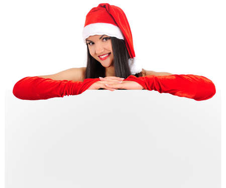 Isolated young brunette christmas girl showing paper photo