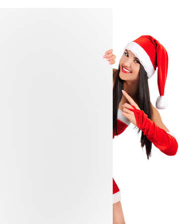 Isolated young brunette christmas girl showing board Stock Photo - 16764071