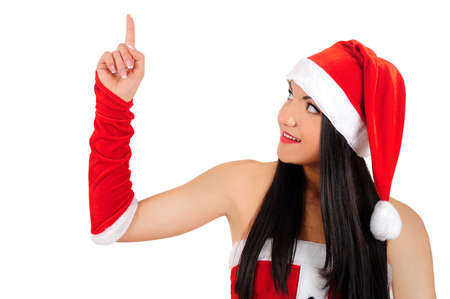 Isolated young brunette christmas girl pointing something photo
