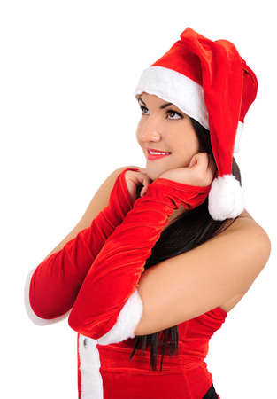 Isolated young brunette christmas girl looking up photo