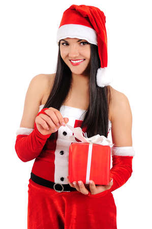 Isolated young christmas girl opening gift Stock Photo - 16764150