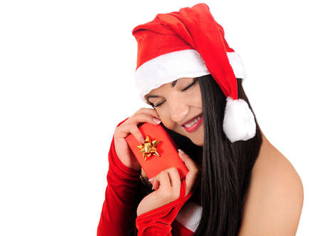 Isolated young christmas girl holding gift photo
