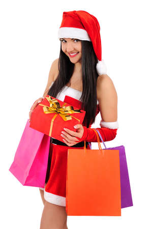 Isolated young christmas girl with shopping gift photo