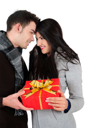 Isolated young casual couple holding gift photo