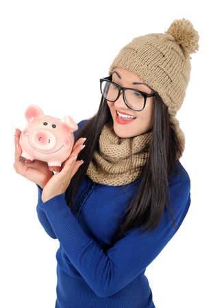 christmas debt: Isolated young casual woman with piggy bank Stock Photo