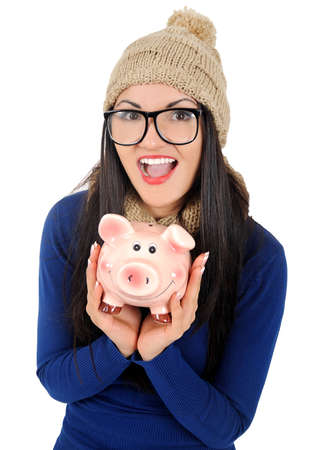 Isolated young casual woman with piggy bank photo