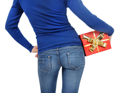 Isolated young casual woman with gift box photo