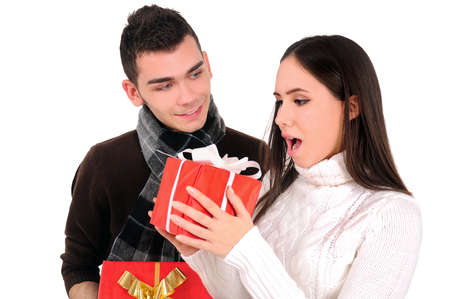 Isolated young casual couple with gift Stock Photo - 16865636