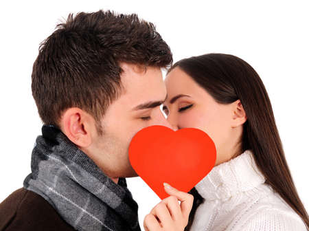 kissing mouth: Isolated young casual couple kissing