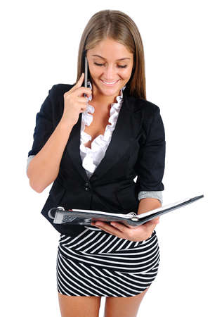Isolated young business woman reading agenda photo