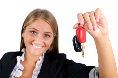 Isolated young business woman showing car key photo