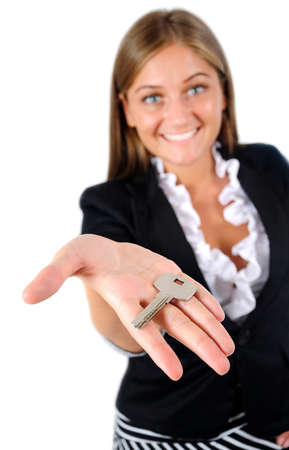 Isolated young business woman giving key photo