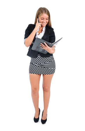 Isolated young business woman speaking phone
