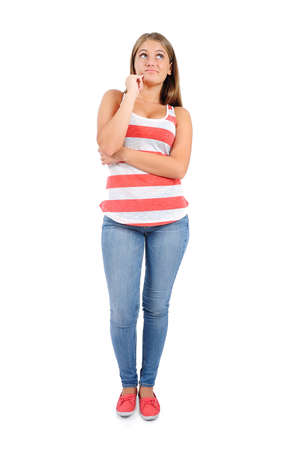 Isolated young casual woman thinking photo