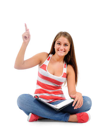 down sitting: Isolated young casual woman pointing