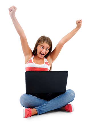 Isolated young casual woman using laptop photo