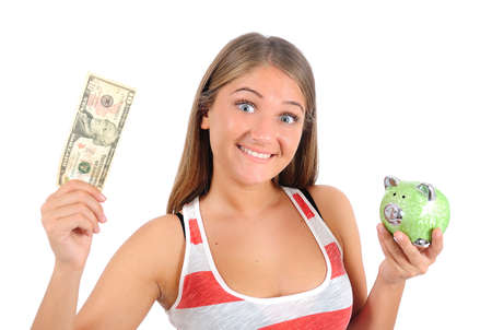Isolated young casual woman with piggybank photo