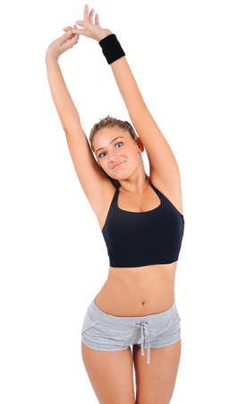 Isolated young fitness woman stretching Stock Photo - 16863533