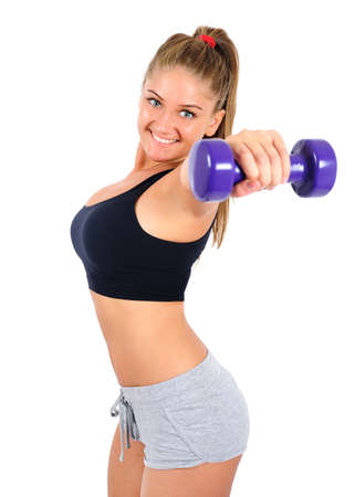 Isolated young fitness woman with dumbbell Stock Photo - 16863703
