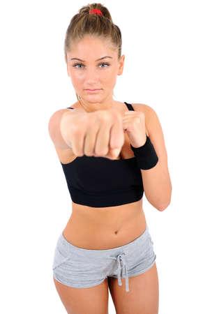 pu�os cerrados: Aislado aptitud joven lucha mujer Foto de archivo